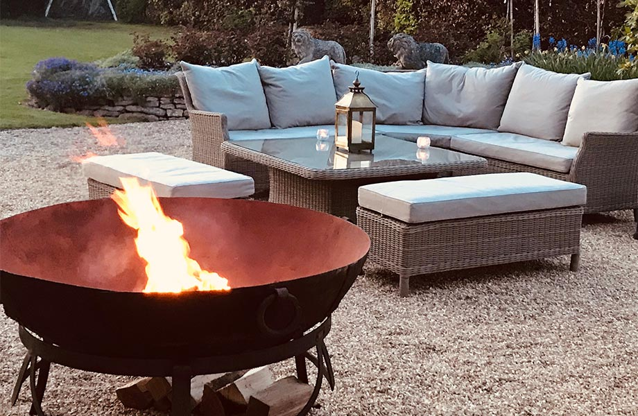 Detail shot of outdoor seating area at Abbots Grange with roaring fire pit on show