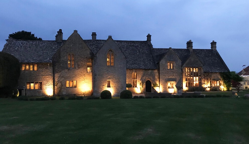 Exterior shot of Abbots Grange building lit up at night