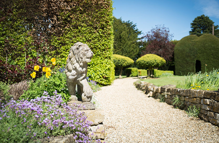 Lion statue on show in the manor gardens