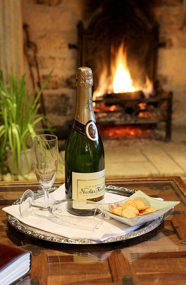 Elizabethan suite bottle of champagne and open fire